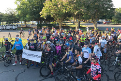 Cyclists gather before a bike ride honoring Nicky Hayden