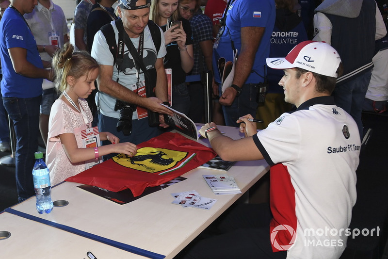 Charles Leclerc, Sauber signs an autograph for a fan