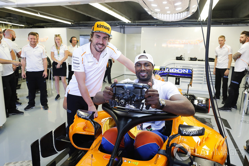 Spaniard Serge Ibaka Congolause of the NBAs Toronto Raptors tries the seat in the car of Fernando Alonso, McLaren MCL33.