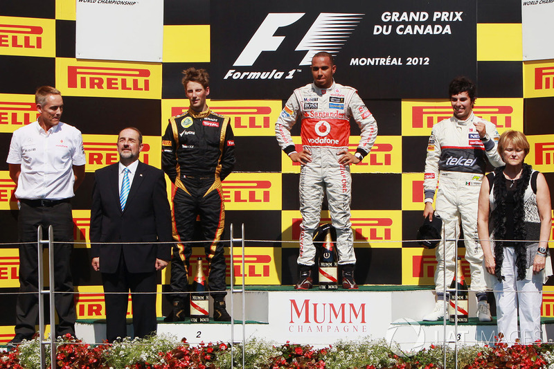 Podium: winnaar Lewis Hamilton, McLaren, tweede Romain Grosjean Lotus F1, derde Sergio Perez, Sauber