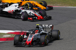 Kevin Magnussen, Haas F1 Team VF-18 Ferrari, leads Romain Grosjean, Haas F1 Team VF-18 Ferrari, and Fernando Alonso, McLaren MCL33 Renault