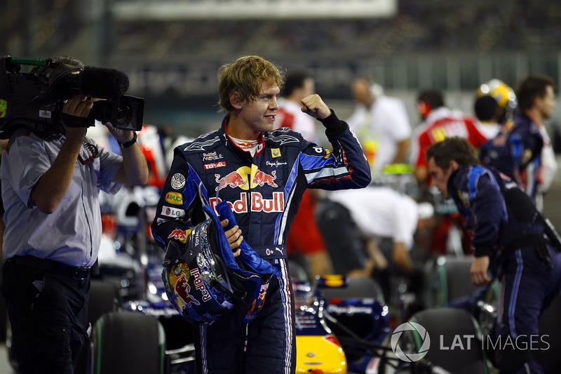 Sebastian Vettel, Red Bull Racing RB6 Renault, celebrates pole in Parc Ferme