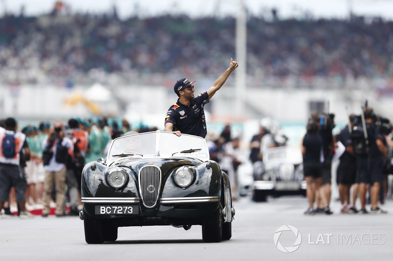 Daniel Ricciardo, Red Bull Racing, waves from a Jaguar XK on the drivers parade
