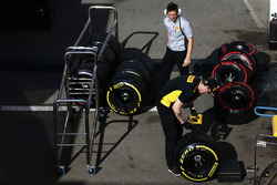 Pirelli technicians work on soft and super-soft tyres
