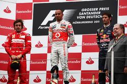 The podium: Fernando Alonso, Ferrari, Lewis Hamilton, McLaren and Mark Webber, Red Bull Racing
