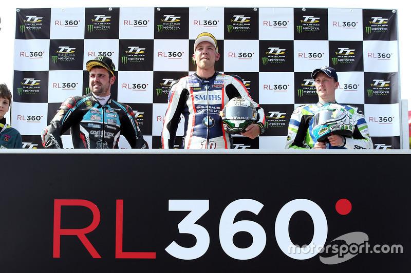 RL360º Superstock TT race winner Peter Hickman celebrates with runner up Michael Dunlop and third pl
