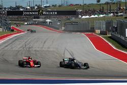 Lewis Hamilton, Mercedes-Benz F1 W08  overtakes Sebastian Vettel, Ferrari SF70H to take the lead