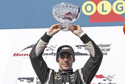 Second place Simon Pagenaud, Team Penske Chevrolet, celebrates on the podium