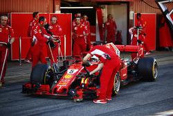 Sebastian Vettel, Ferrari, stops outside of his pit