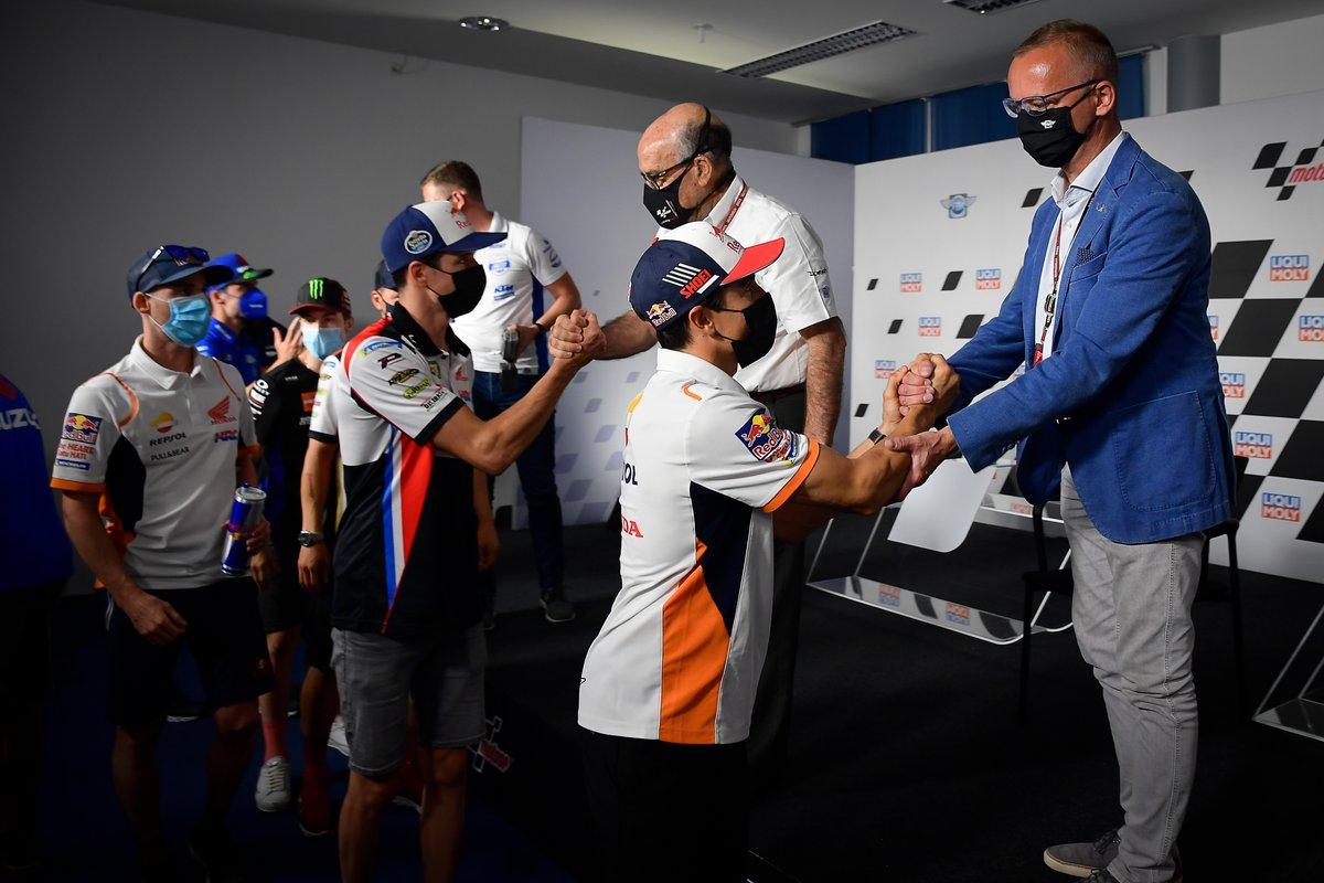 FIM board member Jan Stovicek and Dorna Sports CEO Carmelo Ezpeleta with riders