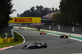 Lewis Hamilton, Mercedes AMG F1 W09 EQ Power+, leads Daniel Ricciardo, Red Bull Racing RB14, and Sebastian Vettel, Ferrari SF71H