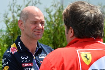 Adrian Newey, Red Bull Racing Chief Technical Officer and Gino Rosato, Ferrari