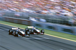 Mika Hakkinen passes David Coulthard McLaren MP4/13