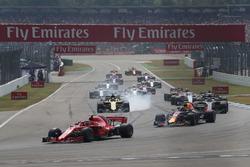 Kimi Raikkonen, Ferrari SF71H and Max Verstappen, Red Bull Racing RB14