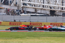 Max Verstappen, Red Bull Racing RB13, Sebastian Vettel, Ferrari SF70H, battle hard at the start of the race as Lewis Hamilton, Mercedes AMG F1 W08, looks to try and take advantage
