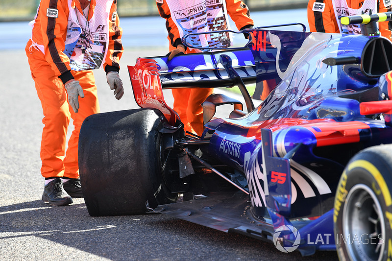 The damaged car of race retiree Carlos Sainz Jr., Scuderia Toro Rosso STR12