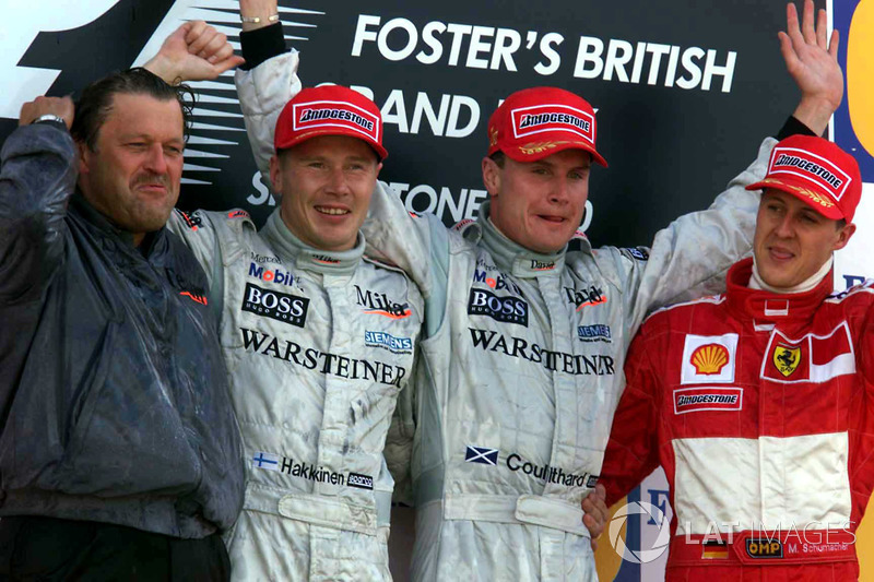 Podium: Race winner David Coulthard, McLaren, second place Mika Hakkinen, McLaren, third place Michael Schumacher, Ferrari and Norbert Haug, Head of Mercedes Sport