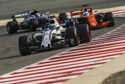 Felipe Massa, Williams FW40, leads Fernando Alonso, McLaren MCL32, and Valtteri Bottas, Mercedes AMG F1 W08