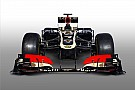 Lotus drivers Grosjean and Raikkonen: The look of love
