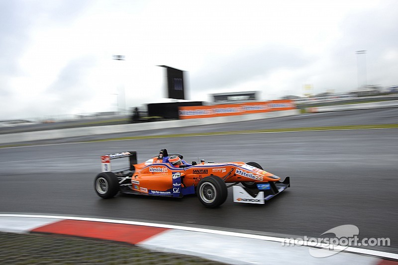 Lucas Auer claims the winner's trophy at the Nürburgring