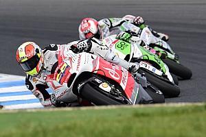 MotoGP Race report Yonny Hernandez celebrates his fiftieth race finishing seventh, his best result in MotoGP
