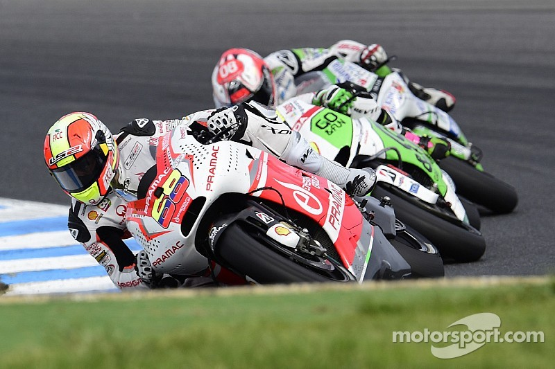Yonny Hernandez celebrates his fiftieth race finishing seventh, his best result in MotoGP