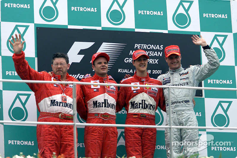 Ross Brawn, Rubens Barrichello, Michael Schumacher y David Coulthard en el podio