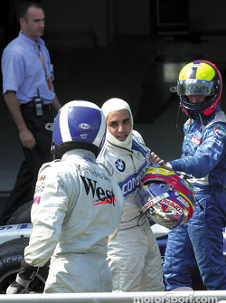 Juan Pablo Montoya shaking hands with David Coulthard while Luciano Burti is lurking