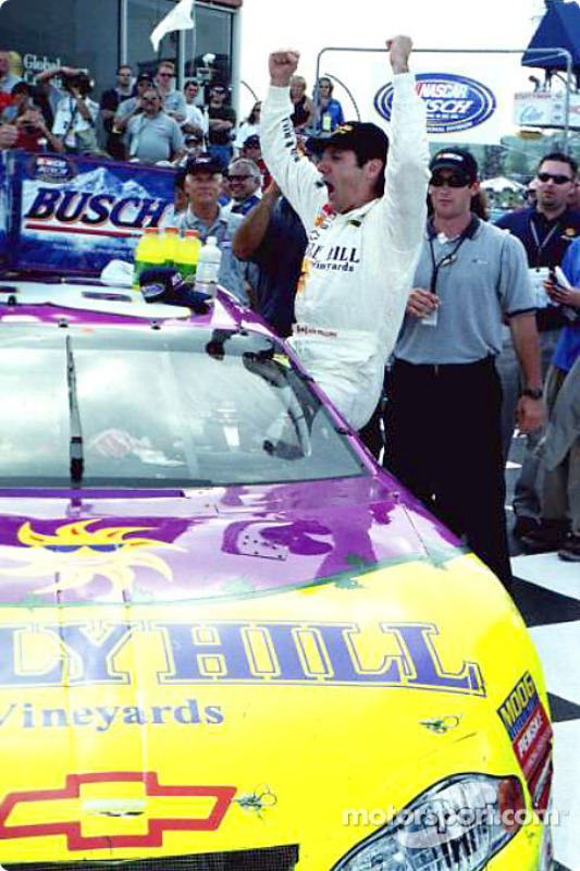 A victorious Ron Fellows exits his race winning car