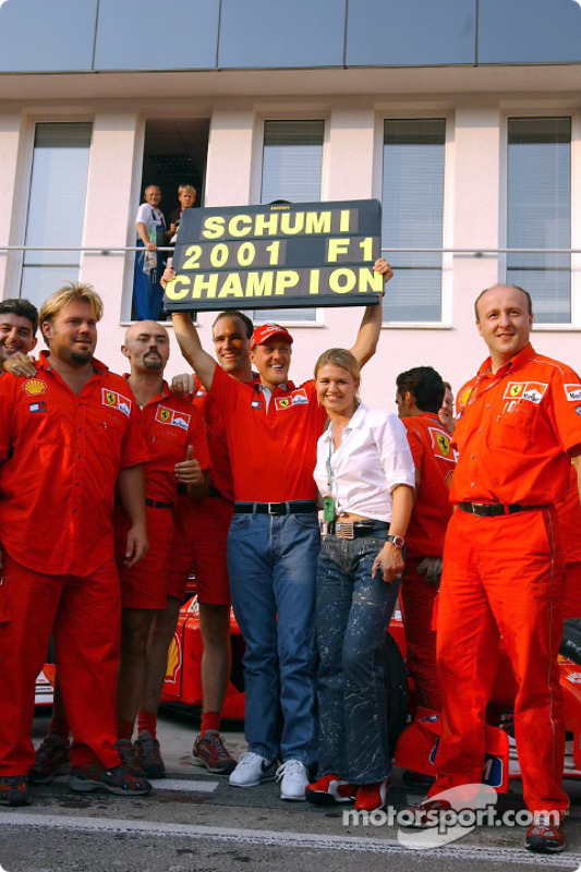 Michael Schumacher celebrating with his wife Corinna and Team Ferrari