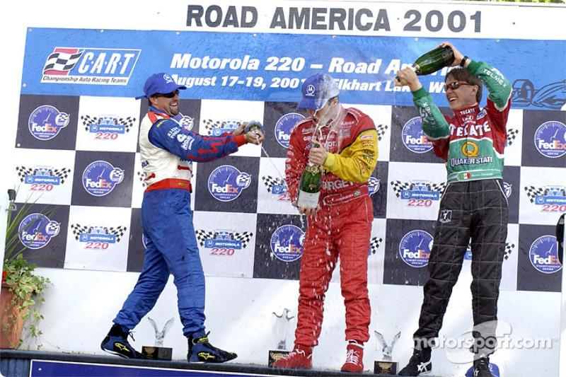 The podium: Michael Andretti, Bruno Junqueira and Adrian Fernandez