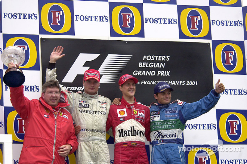 The podium: Ross Brawn, David Coulthard, Michael Schumacher and Giancarlo Fisichella