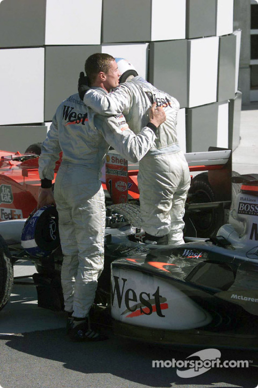 Mika Hakkinen congratulated by David Coulthard