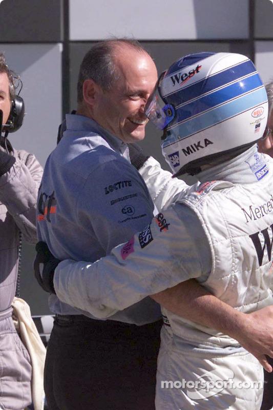 Mika Hakkinen congratulated by Ron Dennis