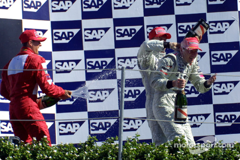The podium: champagne shower for Mika Hakkinen