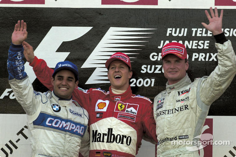 The podium: race winner Michael Schumacher with Juan Pablo Montoya and David Coulthard
