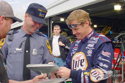 Rusty Wallace signing a speeding ticket (?)