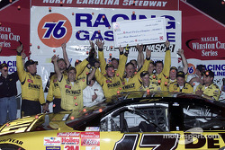 The DeWalt Ford Taurus crew celebrate after winning the pitcrew world championship