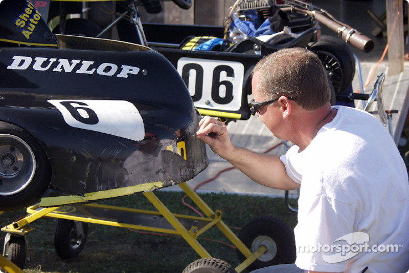 Bill Aschenbach works on his son Lawson's kart. Lawson was the Stock Lite winner