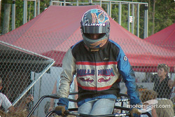 Josh Nash climbs out of his Junior Champ kart after getting swept up in the crash that ended racing