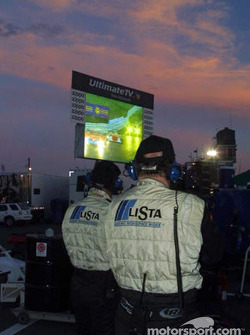 The Doran Lista Racing team watches the race from the pits on the big screen TV