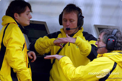 Giancarlo Fisichella discussing with engineers