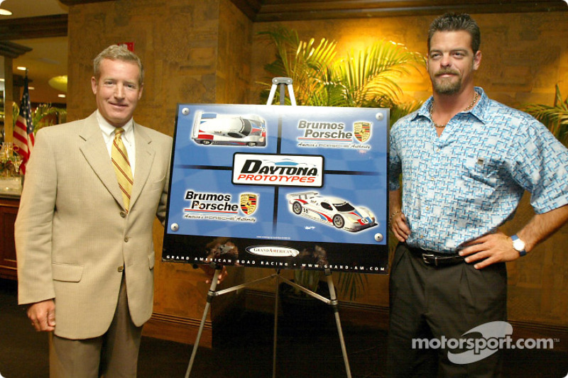 Hurley Haywood and J.C. France pose with an artist's rendering of the new Daytona Prototype coupe that they will team to drive in the 2003 Grand-Am series