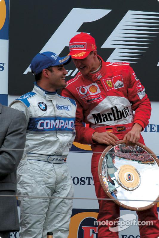 The podium: race winner Michael Schumacher with Juan Pablo Montoya