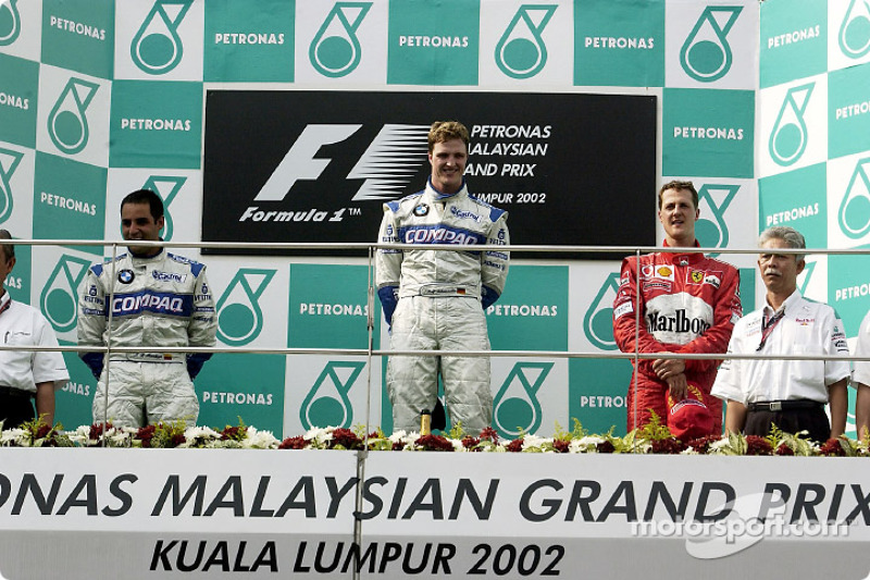 The podium: race winner Ralf Schumacher, Juan Pablo Montoya and Michael Schumacher