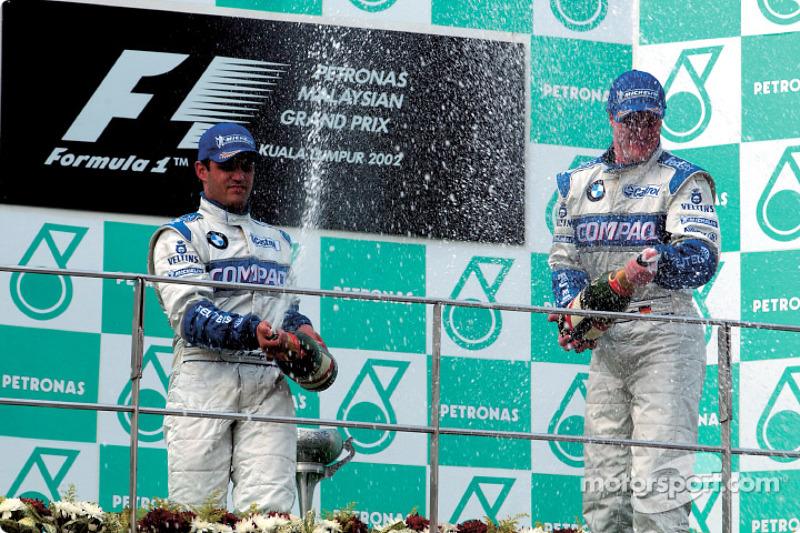 Juan Pablo Montoya et Ralf Schumacher sabrent le champagne