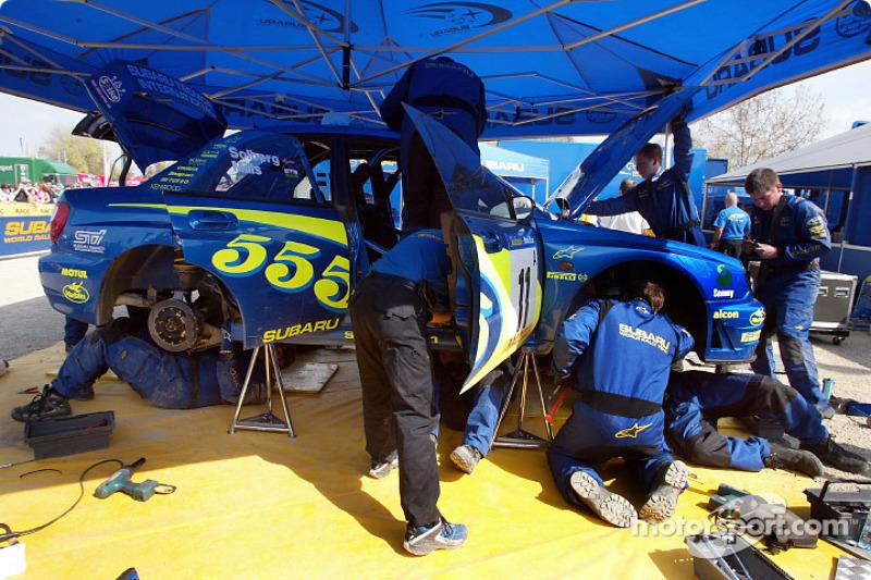 Team Subaru mechanics working the Impreza WRC