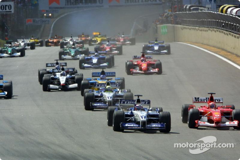 The start: Juan Pablo Montoya and Michael Schumacher charging to the first corner