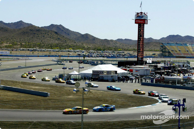A long line of Grand Sport class cars snaking through the road course at Phoenix International Raceway