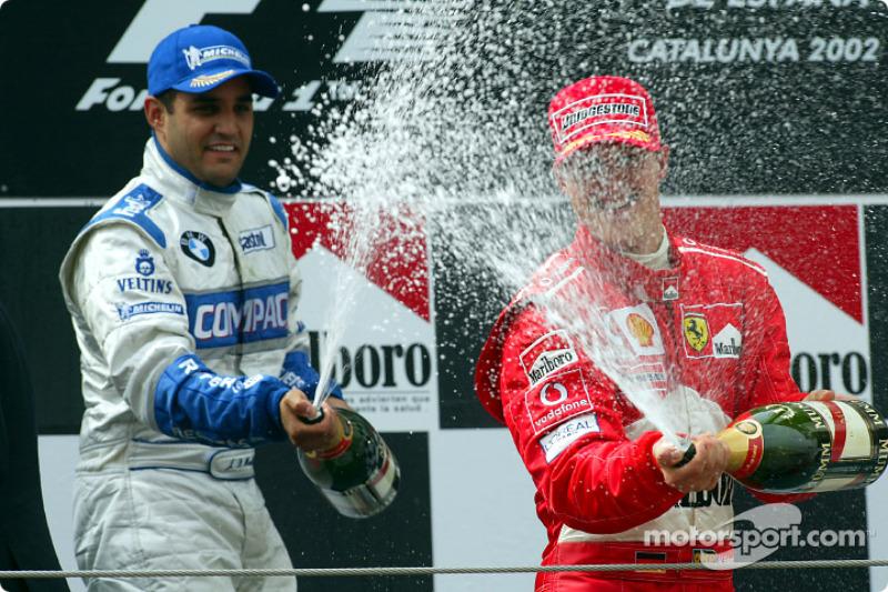 Champagne for Michael Schumacher and Juan Pablo Montoya